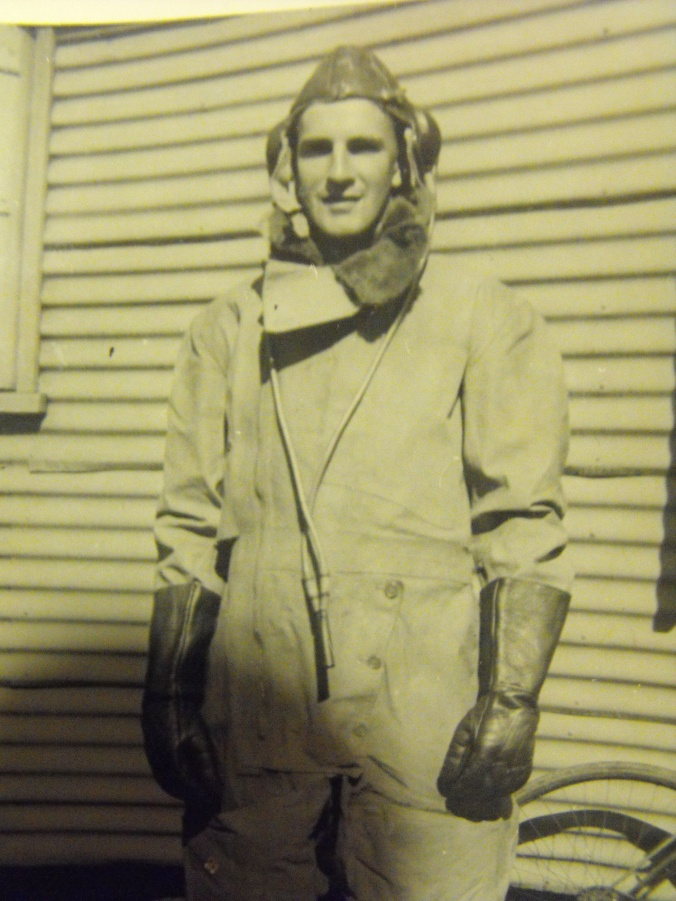 As did war. An airman wearing a Sidcot outfit.