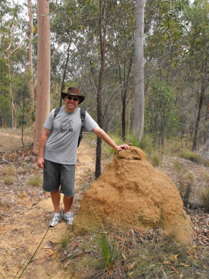 My tall brother modelling with a termite nest.