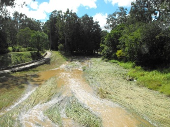 six mile creek flood waters near footbridge