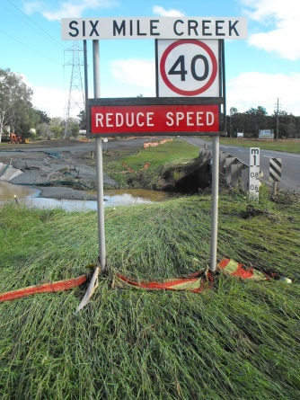 six mile creek flooding and sign