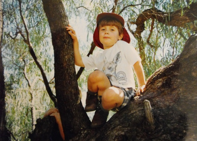 boy-climbing-tree-outback